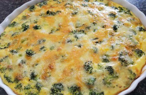 Egg, cheese, and broccoli quiche in white pie dish